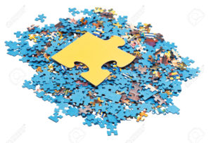 big puzzle piece on pile of disassembled blue jigsaw puzzles isolated on white background